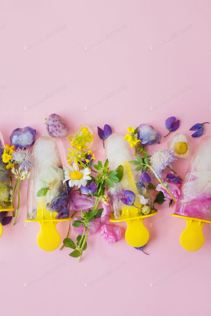 Floral Ice Pops. Colorful wildflowers in frozen popsicles and ice cubes