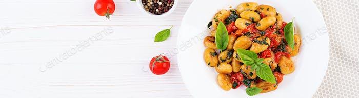 Gnocchi pasta in rustic style.  Italian cuisine. Vegetarian vege