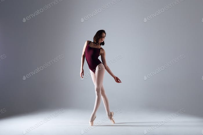 Ballerina dancing in the darkness