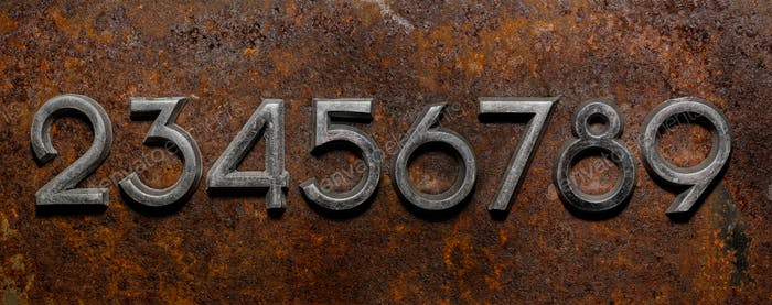 Row of metal cyrillic digits on a rusty background