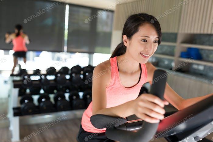 Sport Woman biking at gym
