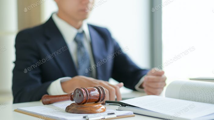 Concepts of legal services: The lawyer provides legal documents for his clients.