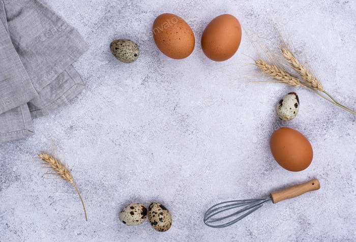 Baking concept with eggs and whisk