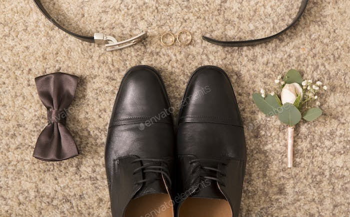 Close up of groom shoes and wedding accessories for him
