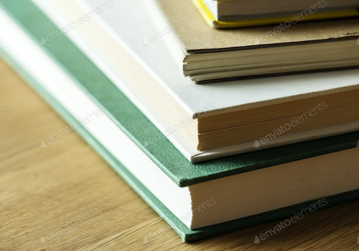 Closeup of stack of antique books educational, academic and literary concept