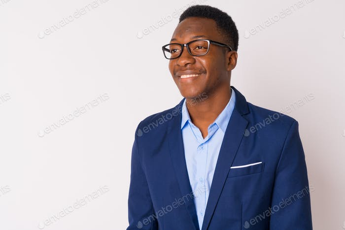 Face of young happy African businessman with eyeglasses thinking
