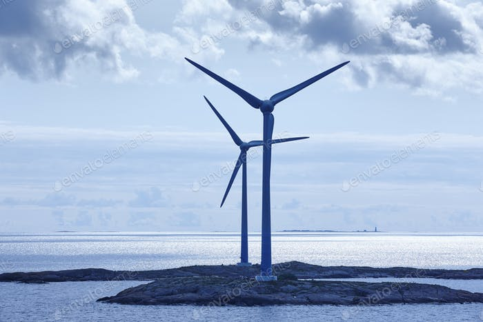 Wind turbines at sunset. Renewable energy. Finland seascape. Horizontal