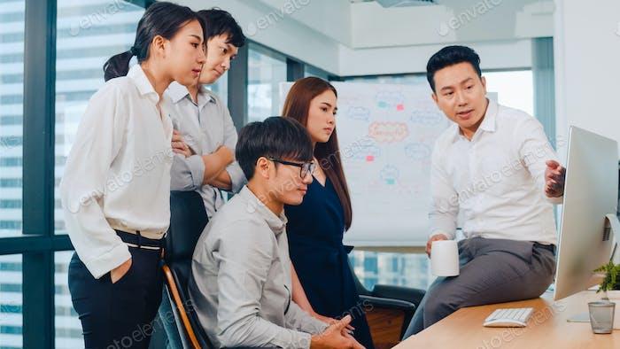 ฺBusinesspeople using computer presentation and communication meeting brainstorming ideas in office.