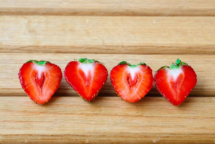 Slices of strawberry on wooden  table background