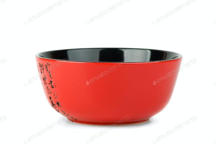 Empty red ceramic bowl