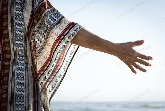 Senior woman reaching out her hand