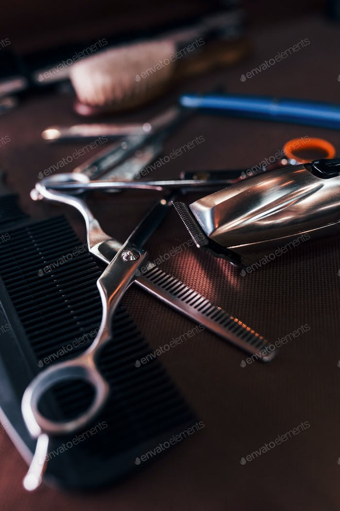 Close up view of vintage barber shop tools that lying down on the table