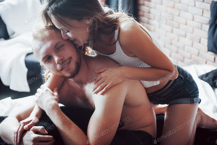 Sensual relationships, husband and wife play in bed