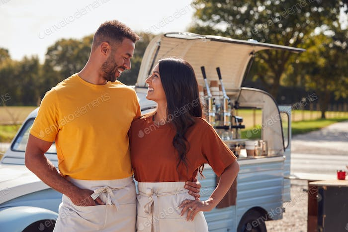 Couple Running Independent Mobile Coffee Shop Standing Outdoors Next To Van