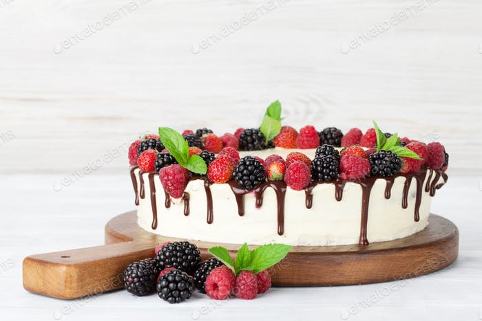 Cake with chocolate and berries
