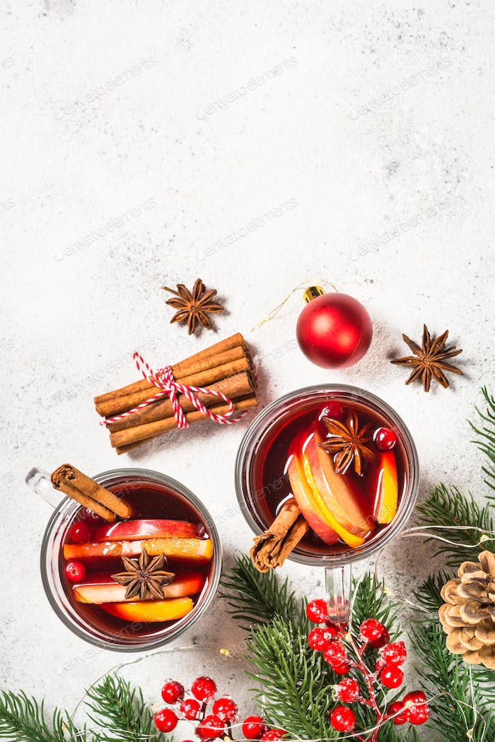 Mulled wine with christmas decorations on white