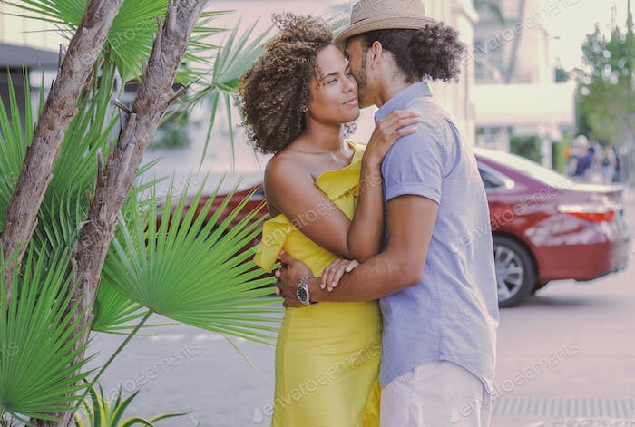 Couple standing and embracing on the street