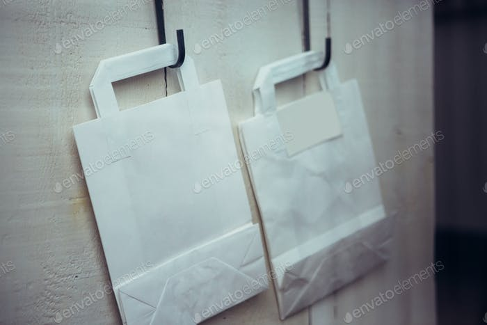 Two paper bags on wall