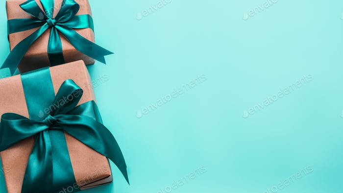 Gift boxes in craft paper and satin ribbon, banner