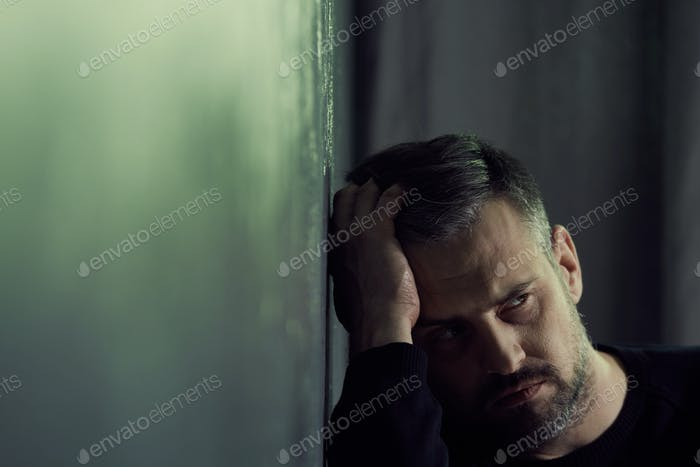 Man in a dark room at night