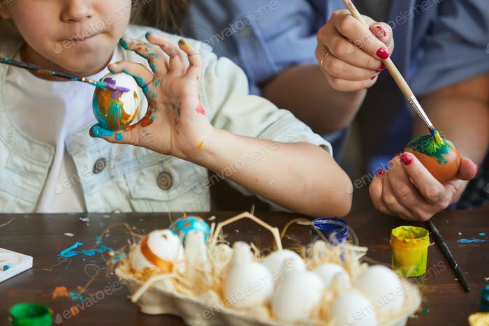 Litte Girl Painting Easter Eggs Closeup
