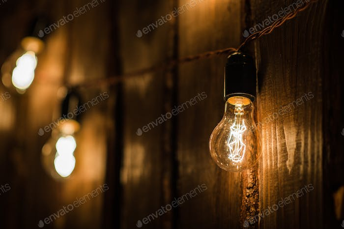 Retro Lamp With Plug And Cable Hanging On The Wooden Wall