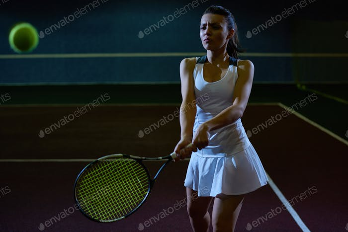 Woman in Tough Tennis Practice