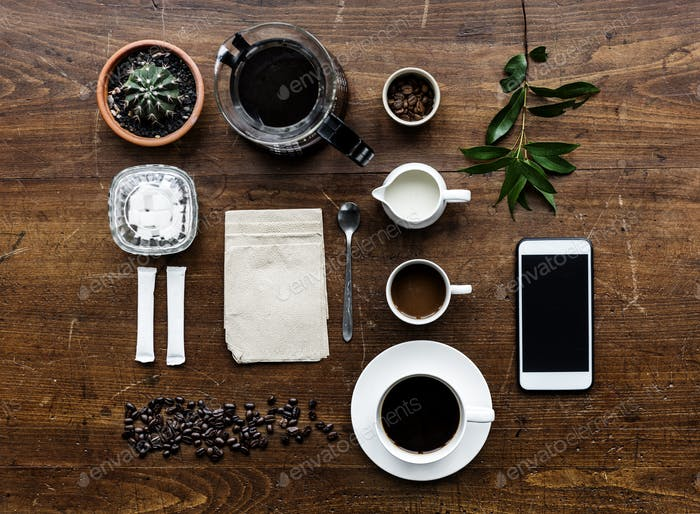 Aerial view of coffee setting on wooden table