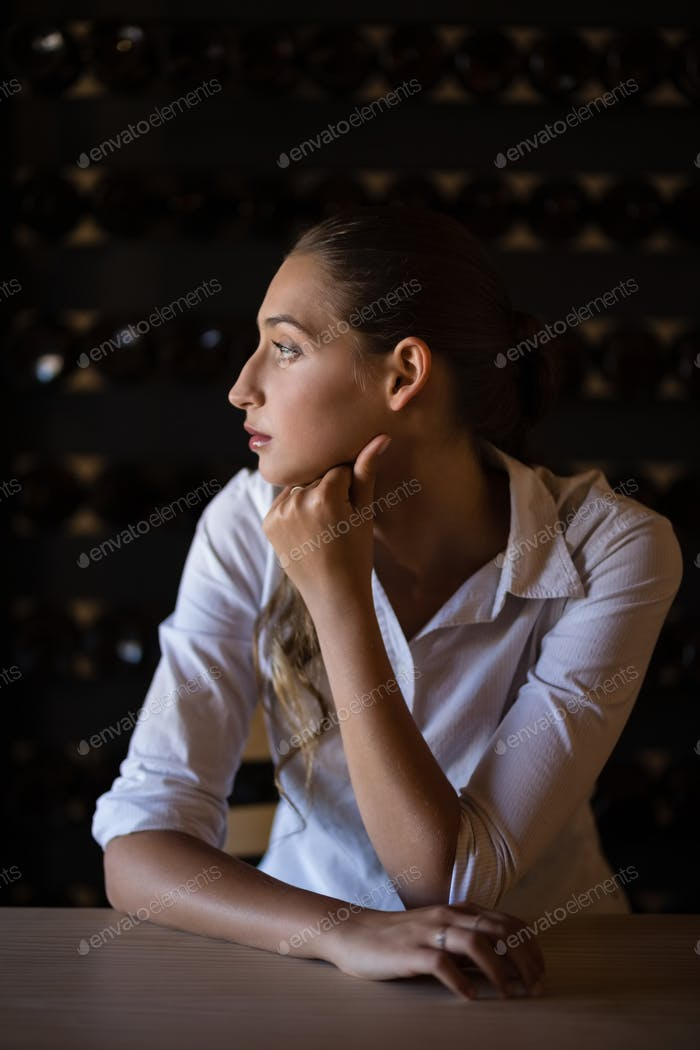 Thoughtful woman sitting at counter