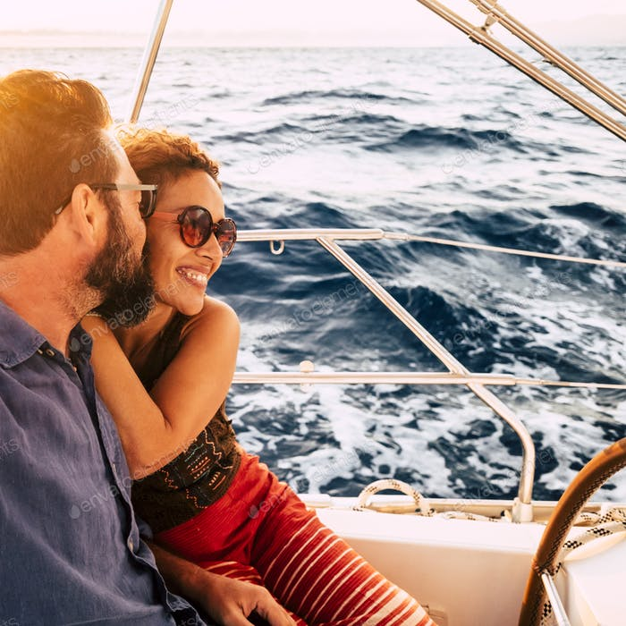 Couple in happiness enjoy a sail tour in yacht