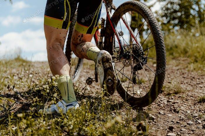 back dirty feet mountain biker