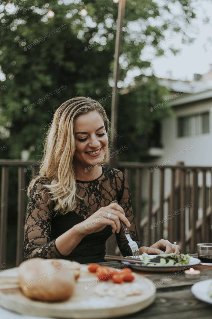 Blonde woman at a bbq party
