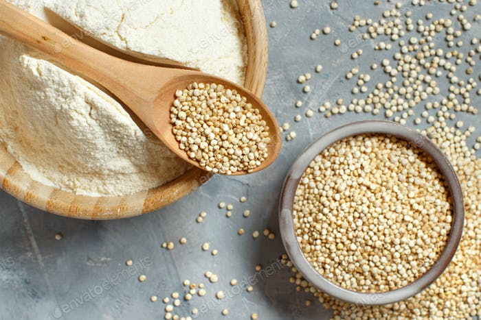 Raw white quinoa seeds and flour top view