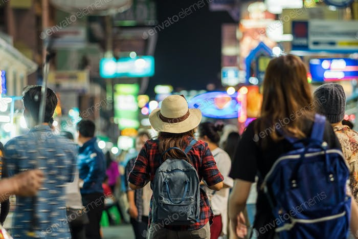 Back side of Young Asian traveling women walking and looking in Khaosan Road walking