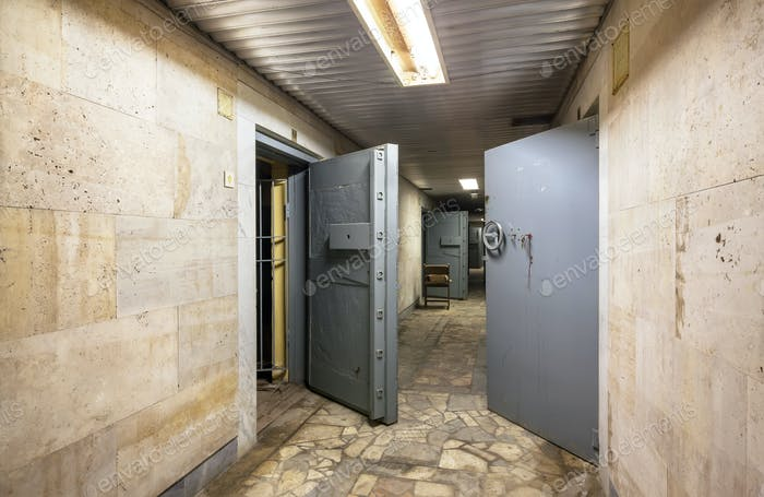 Corridor with open armored doors in an abandoned financial institution