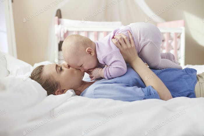 Cuddles with mommy in the bed
