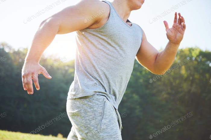 Person running working out living an active lifestyle training cardio in summer