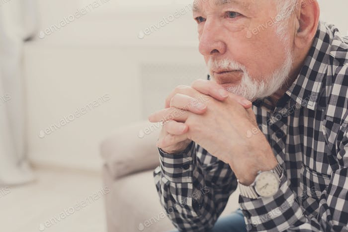 Pensive elderly man portrait, copy space