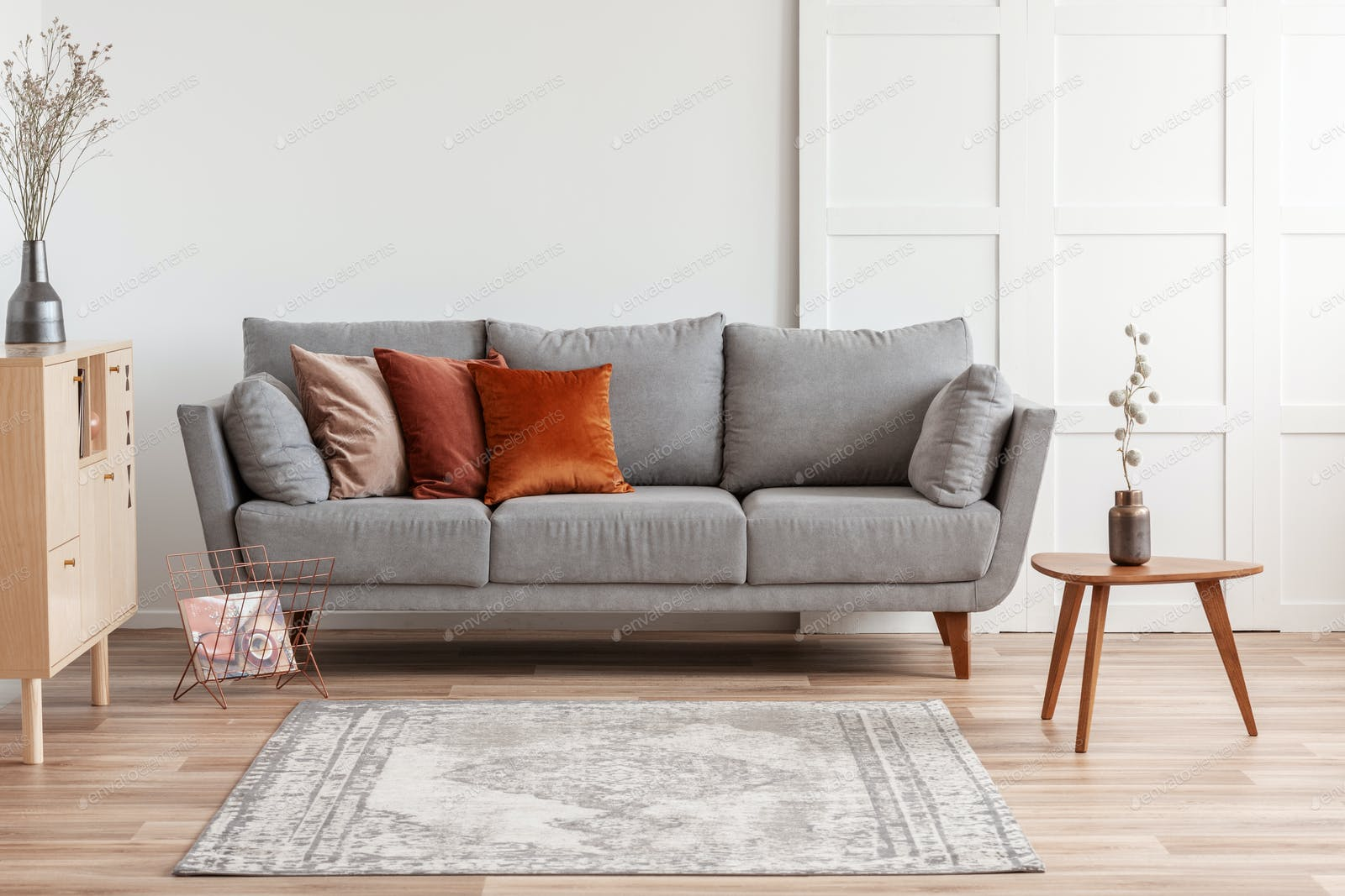 Orange Red And Beige Pillows On Grey