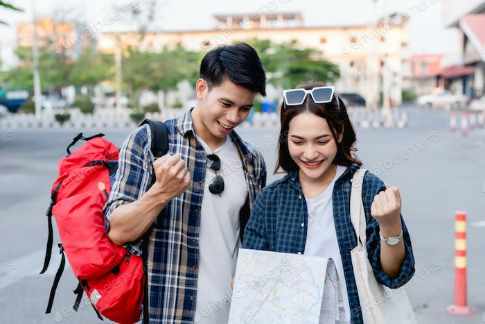 Young backpacker couple feel glad when arrived at destination
