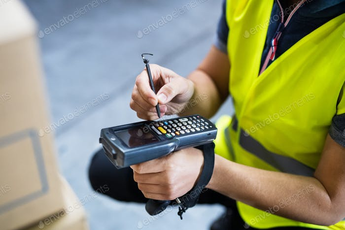 Male warehouse worker with barcode scanner.