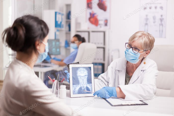 Senior doctor with mask against covid-19