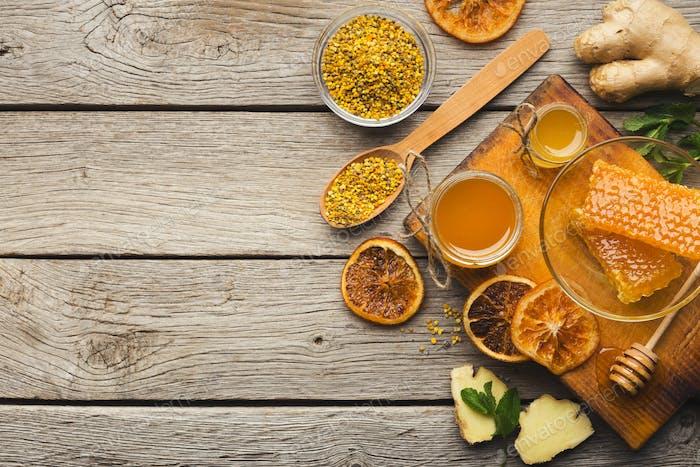 Various types of honey on wooden platter