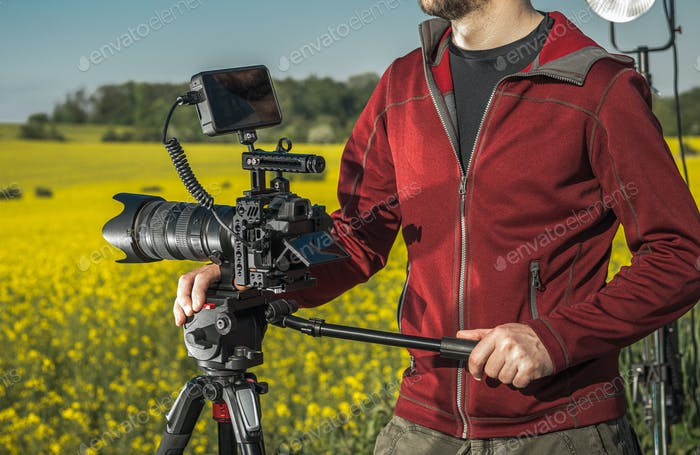 Videographer Operator with Professional Digital Camera