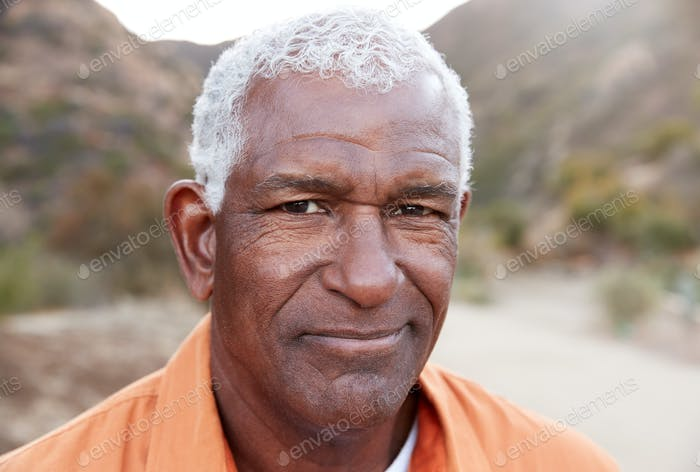 Outdoor Portrait Of Serious African American Senior Man With Mental Health Concerns