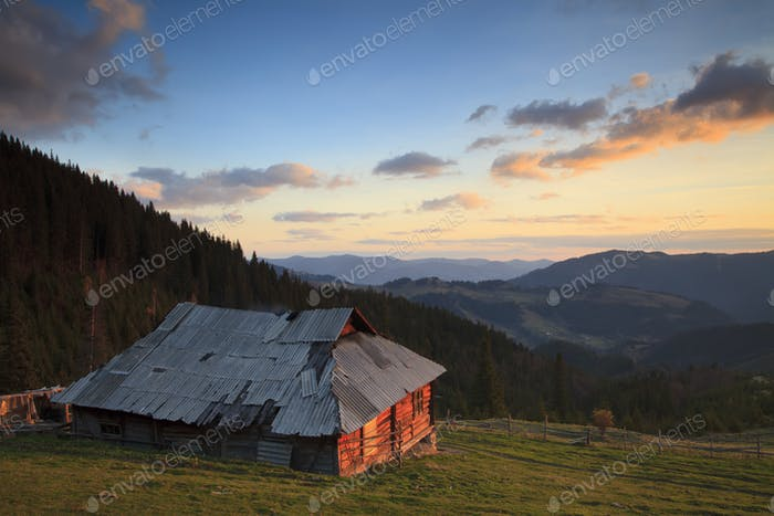 Old house in the mountains at dawn