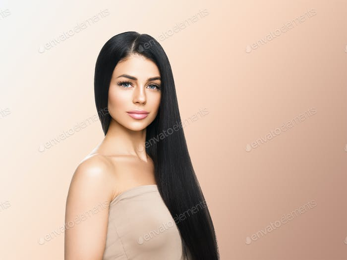 Beautiful woman healthy skin care concept portrait close up beige background. Studio shot