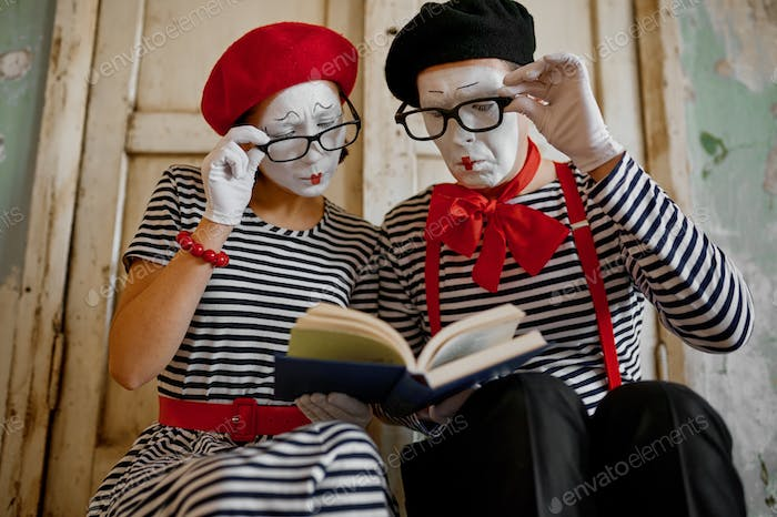 Two clowns in glasses, mime artists, parody comedy