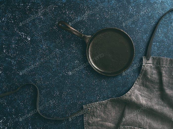 denim cotton apron on dark background, copy space