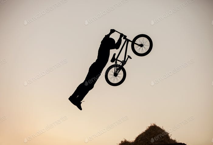 Extreme rider making a bike jump